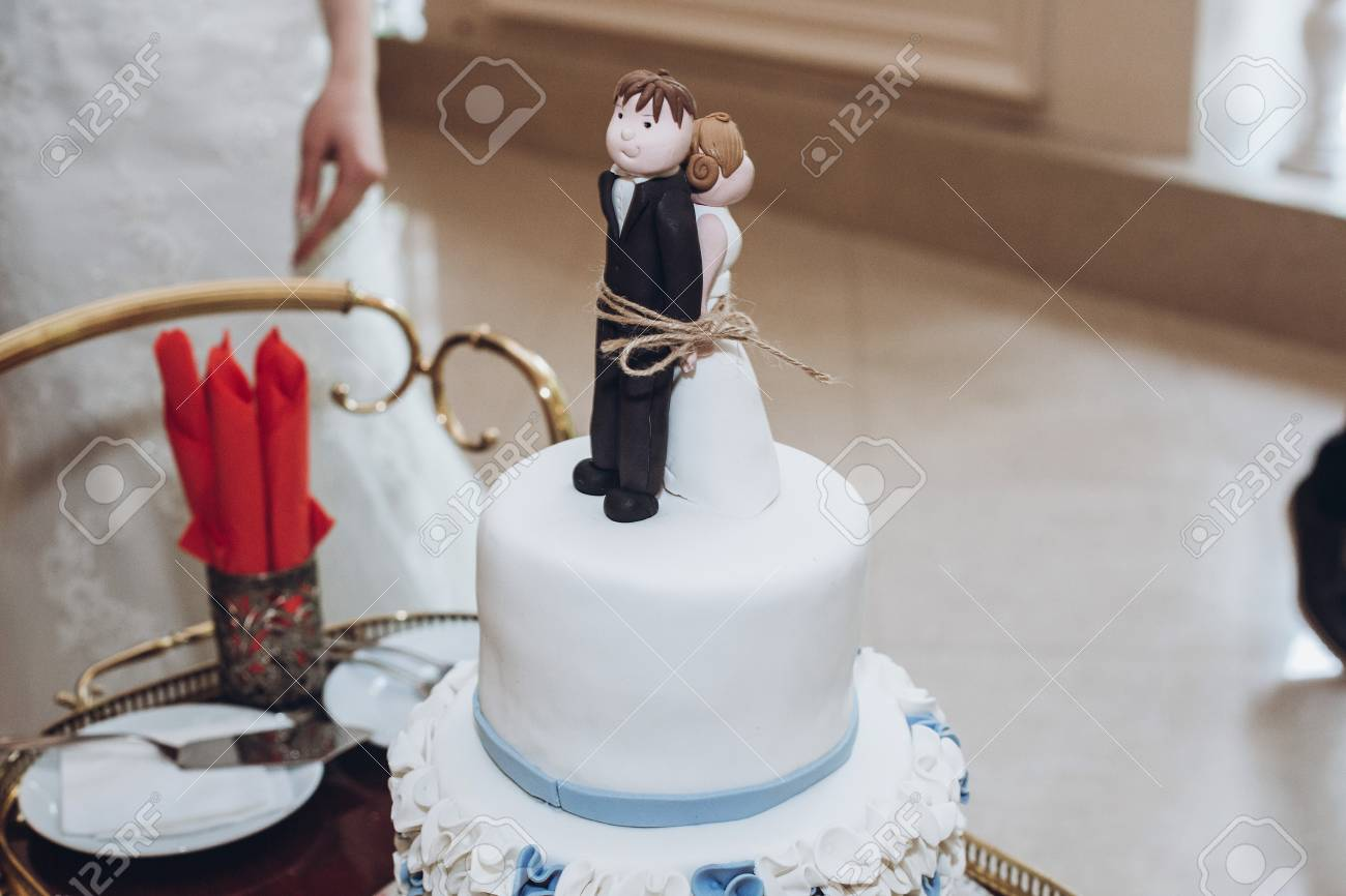 Funny wedding cake topper figurines of bride and groom tied stock funny wedding cake topper figurines of bride and groom tied together with a rope junglespirit Images