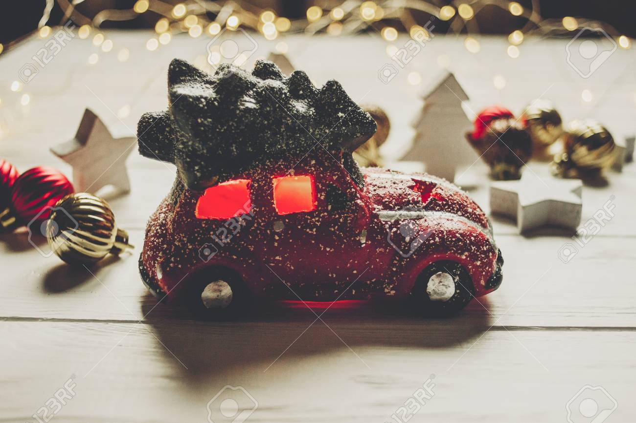 Car Christmas Ornaments.Red Car Toy With Christmas Tree On Top And Simple Ornaments On