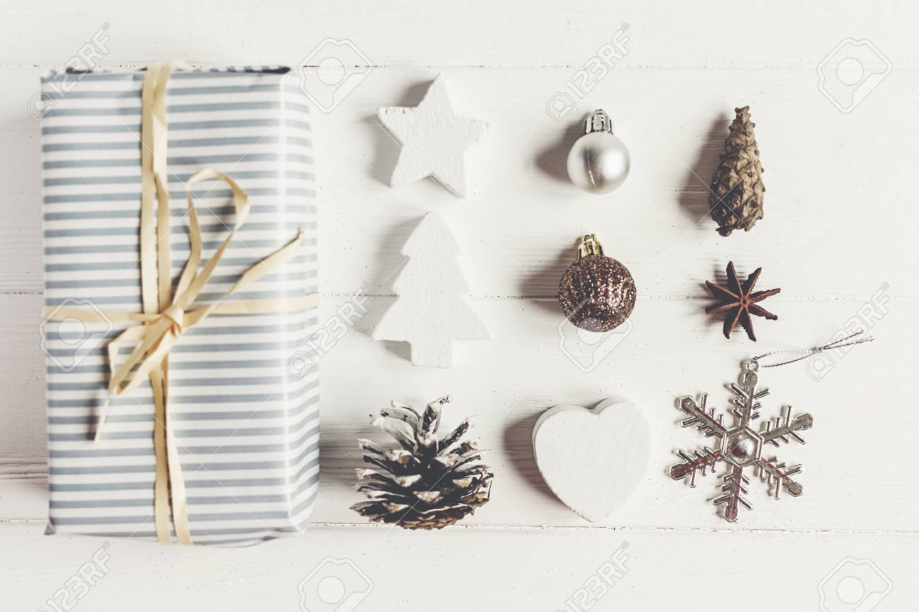 modern christmas flat lay composition stylish wrapped present with ornaments and cones anise on rustic - Modern Christmas Ornaments