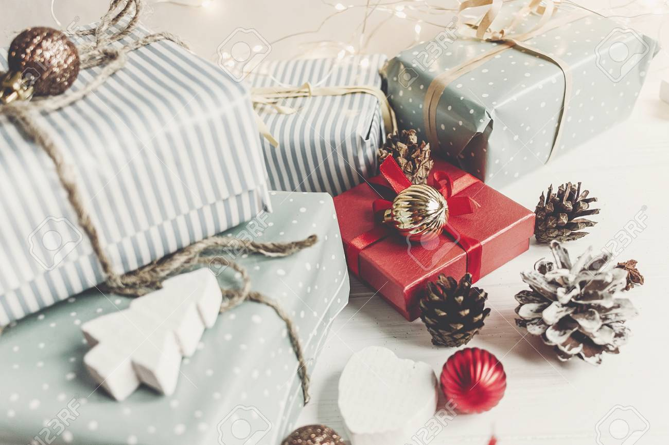 Stylish Christmas Wrapped Presents With Ornaments And Cones On ...