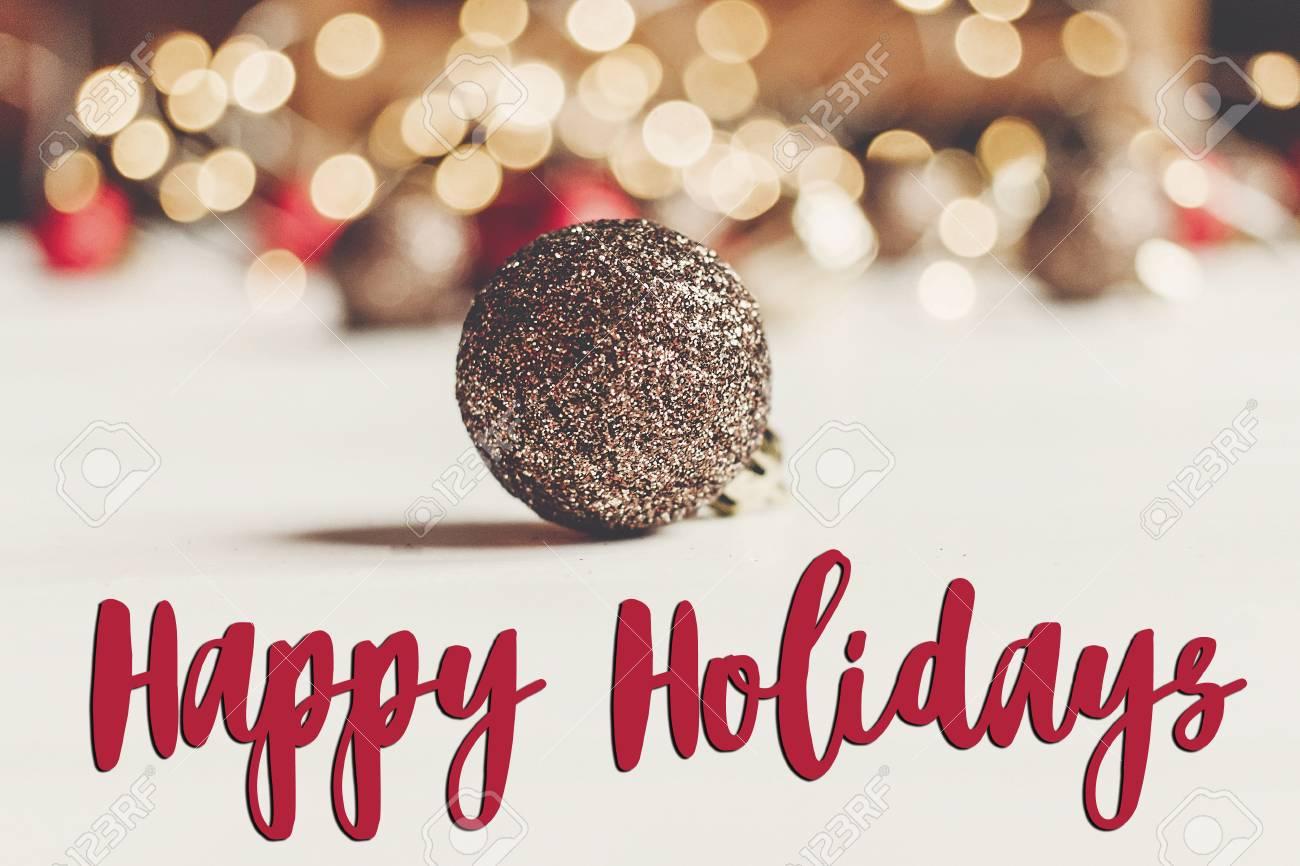 Happy holidays text seasonal greetings card sign glitter christmas happy holidays text seasonal greetings card sign glitter christmas ornament with illumination lights on m4hsunfo