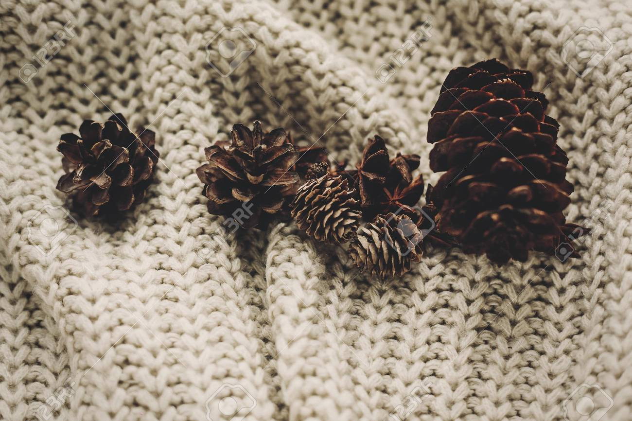 Stylish Pine Cones And Anise On Rustic Knitted Sweater Background ...