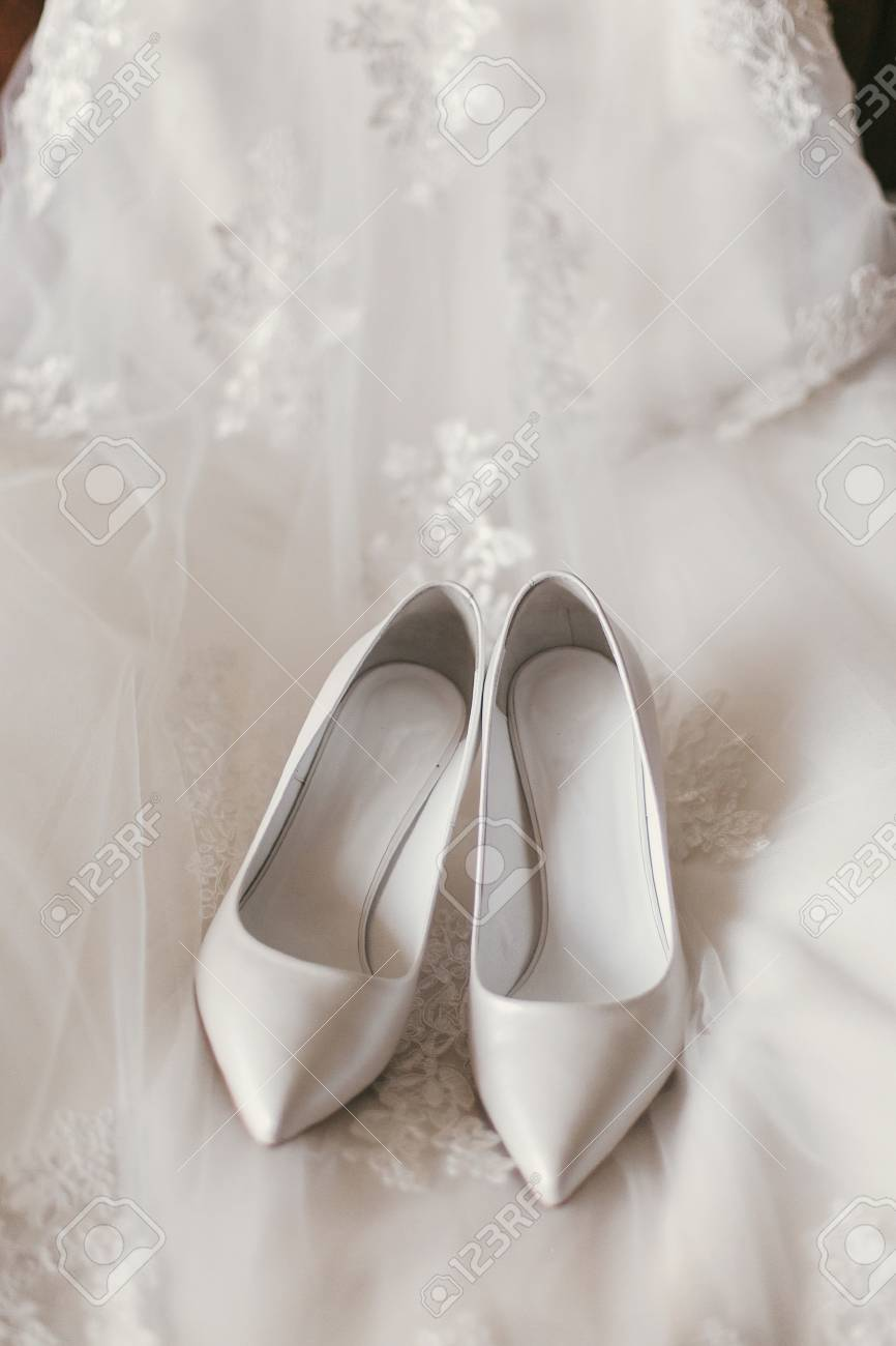 Wedding Dress Shoes.Beautiful Stylish Shoes On Luxury Silk Wedding Dress Simple