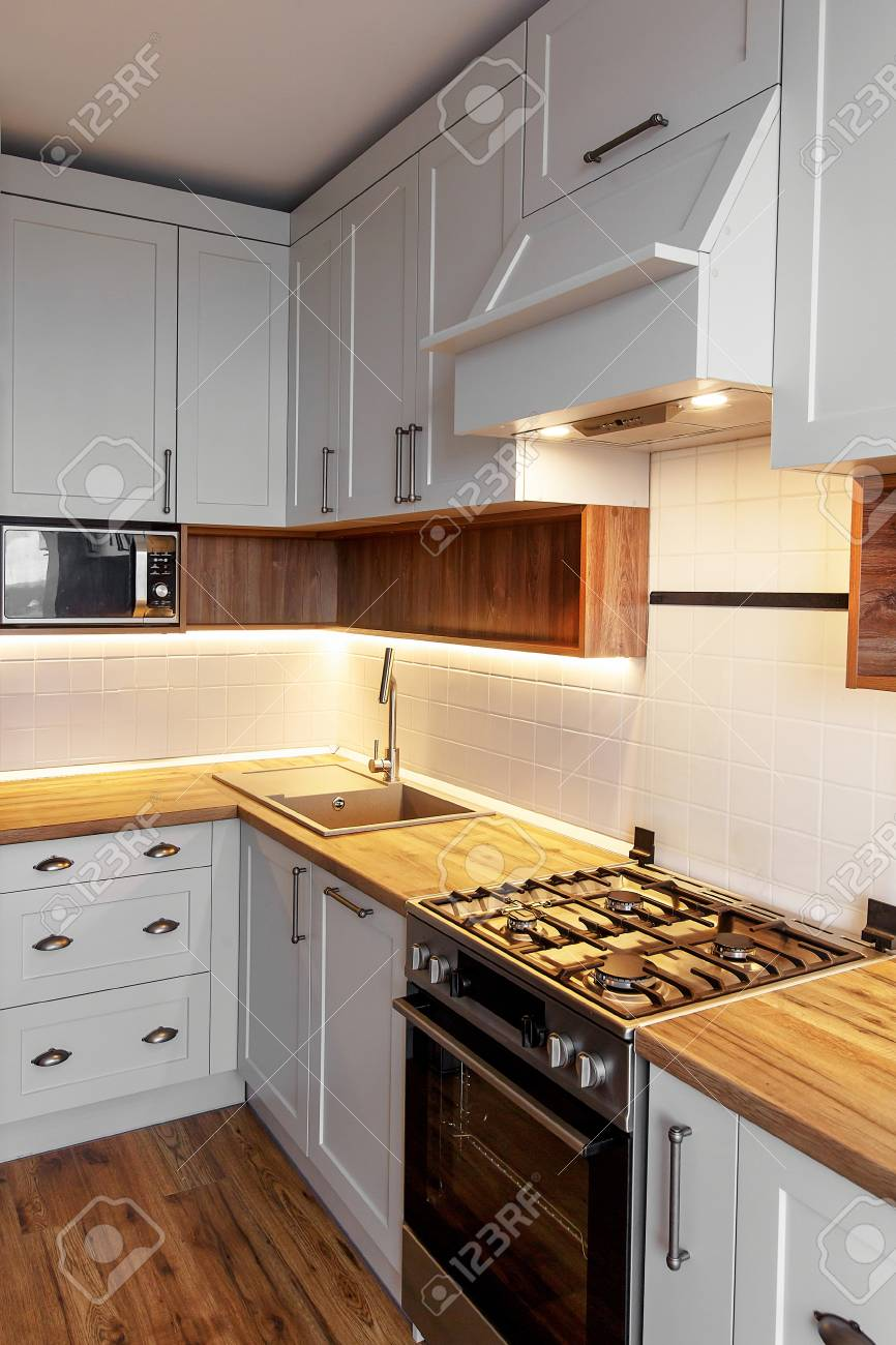 Stylish Light Gray Kitchen Interior With Modern Cabinets With