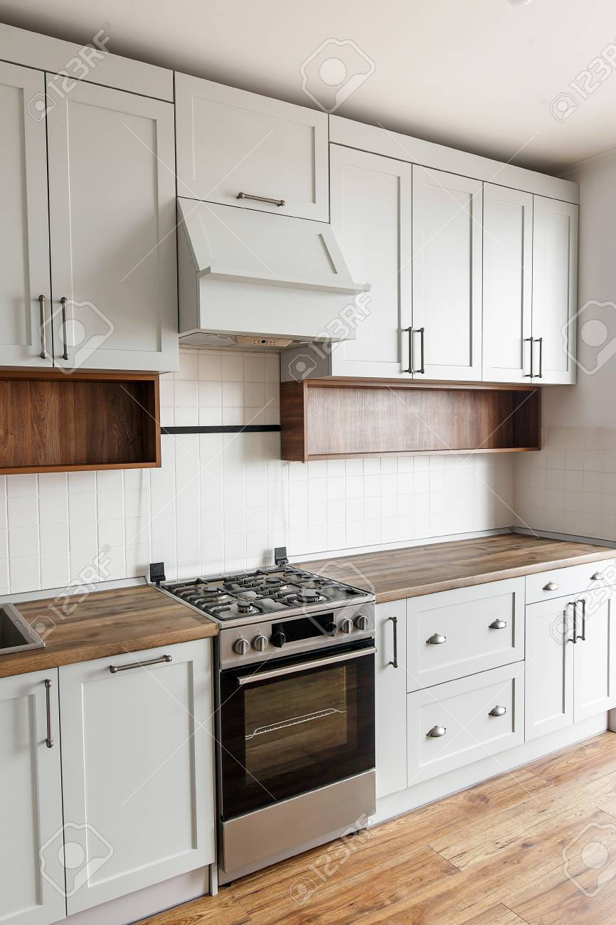 Stylish Light Gray Kitchen Interior With Modern Cabinets And Stock Photo Picture And Royalty Free Image Image 104666938