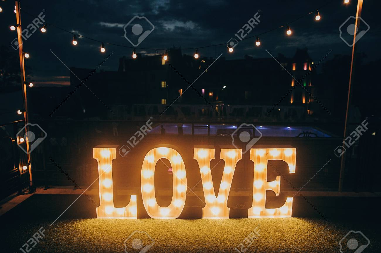 Big White Love Letters In Light Bulbs For Photo Booth At Wedding
