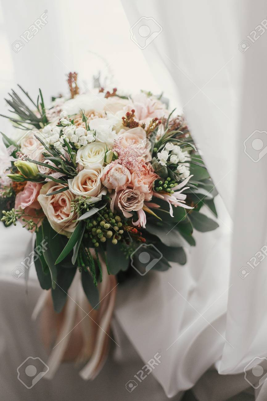 Stylish Wedding Bouquet Of Pink Roses And Green Eucalyptus On