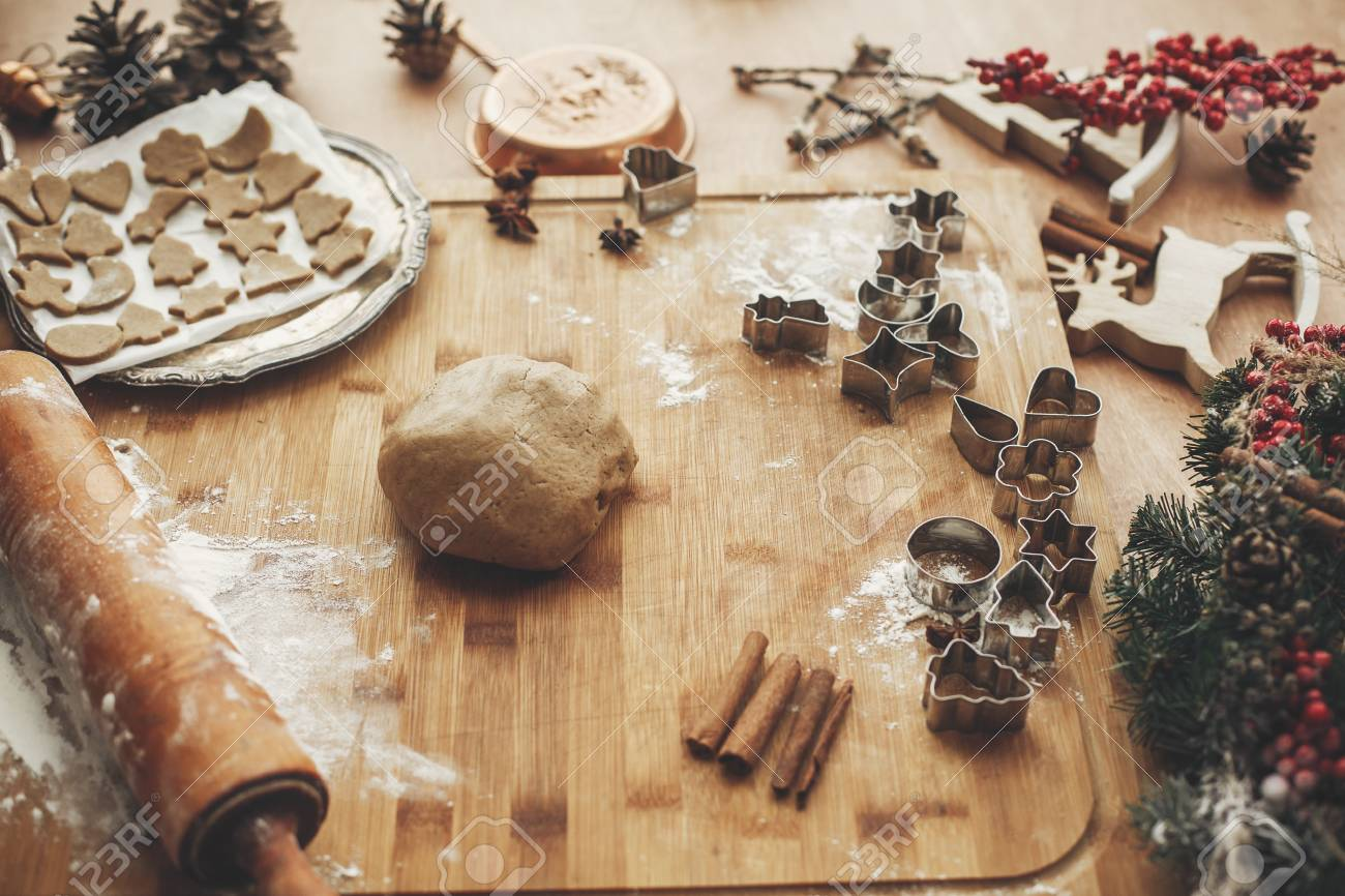 Making Christmas Gingerbread Cookies Dough With Metal Cutters
