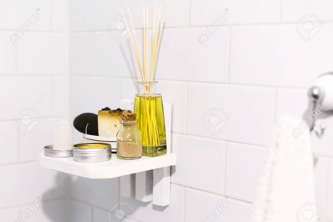 Zero waste bathroom concept. Eco natural shampoo in metal can, deodorant, soap and ayurveda ubtan powder in glass on wooden shelf in bathroom, plastic free items. Sustainable lifestyle - 123895360