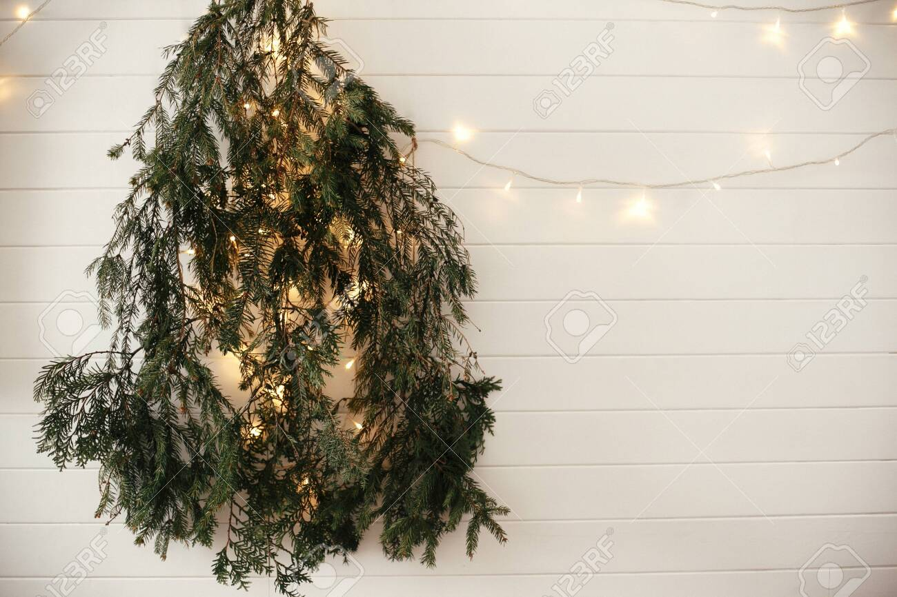 Stylish Modern Christmas Tree Made Of Fir Branches Hanging On Stock Photo Picture And Royalty Free Image Image 127586360