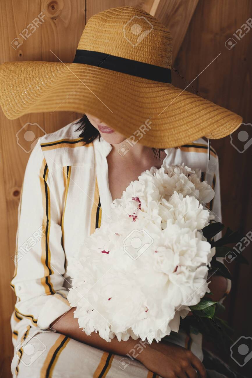 Portrait Of Boho Woman In Hat Holding White Peony Bouquet On Stock Photo Picture And Royalty Free Image Image 138168866