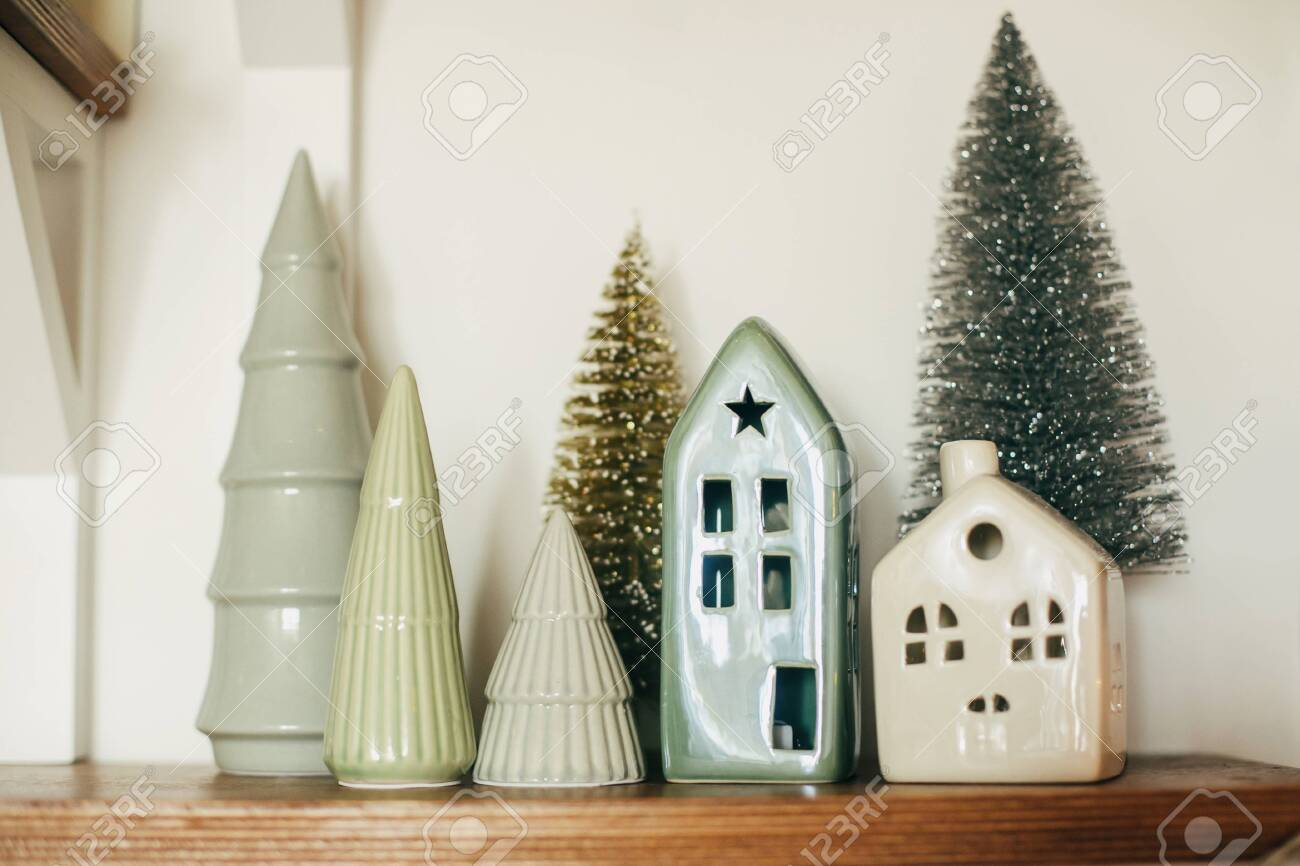 Modern Little Christmas House And Trees On Wooden Shelf Stylish Stock Photo Picture And Royalty Free Image Image 154062664