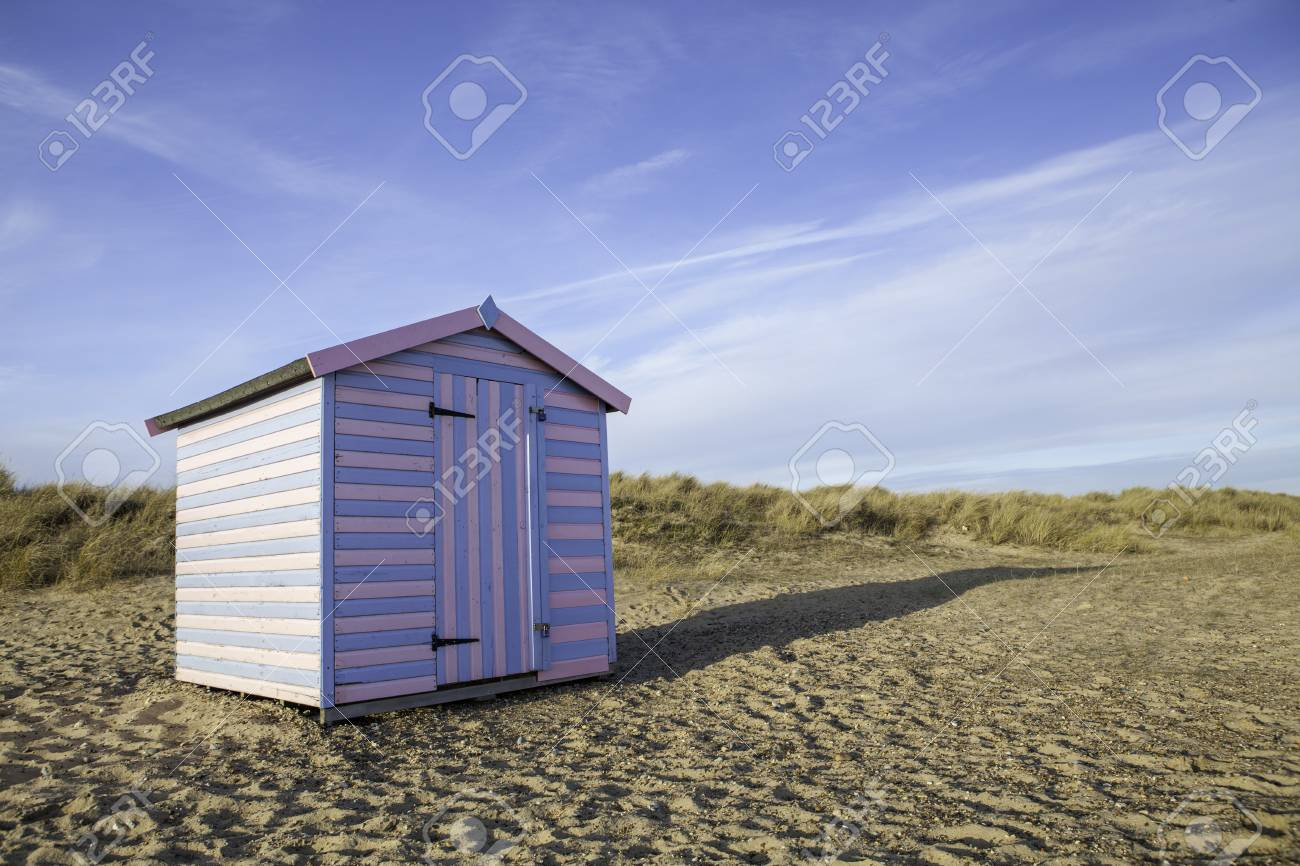 A Small Fun Pink And Blue Striped Beach Hut Symbolic Of A Beach