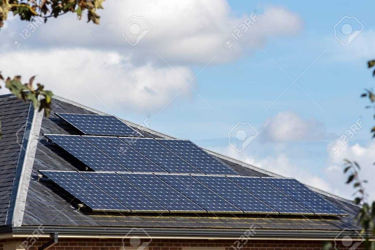 Solar Panels On Slate Tiled Roof Of Modern House, Renewable Energy ...