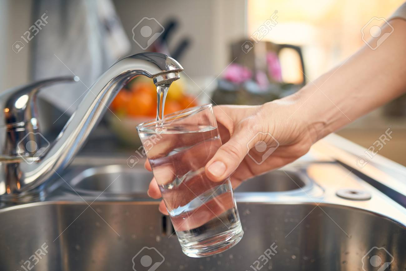 Pouring Fresh Tap Water Into a Glass - 93922827