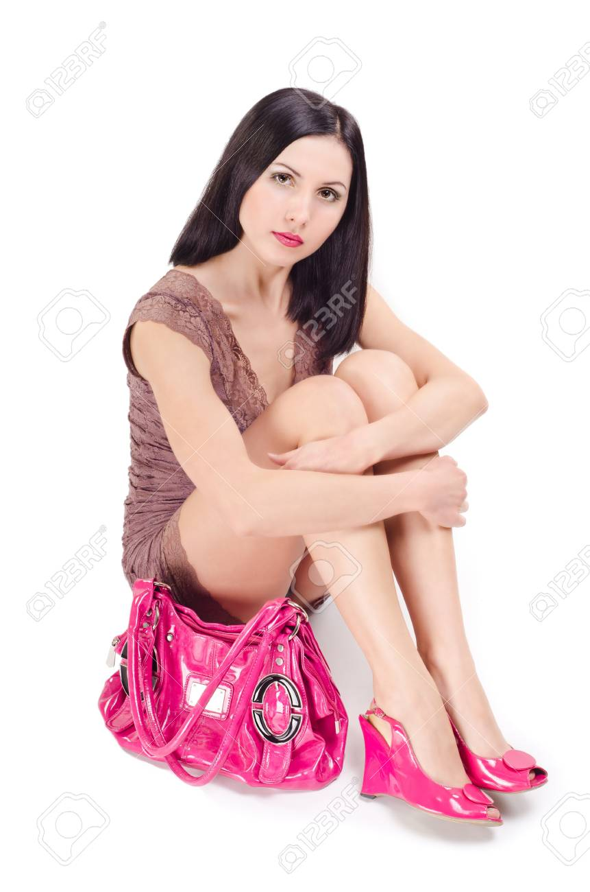 Woman sitting on the floor with a bag Stock Photo - 17664305