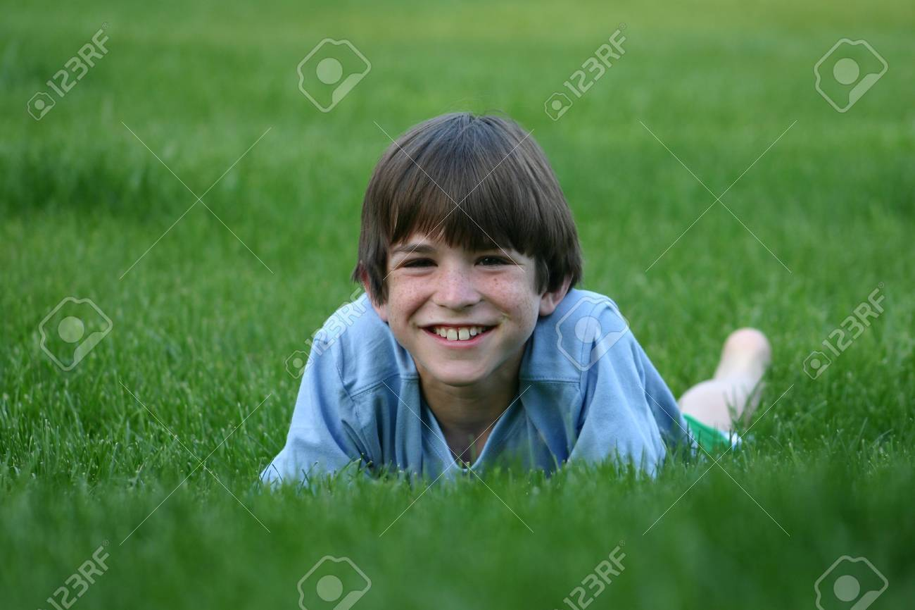 Boy Laying in Grass Stock Photo - 426390