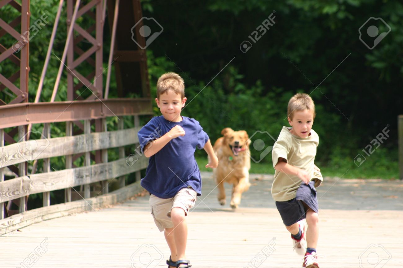 Boys Running With Dog Stock Photo, Picture And Royalty Free Image. Image  490631.