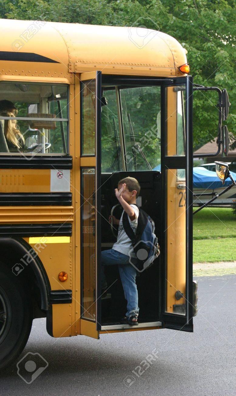 Boy Waving Getting on School Bus Stock Photo - 527187