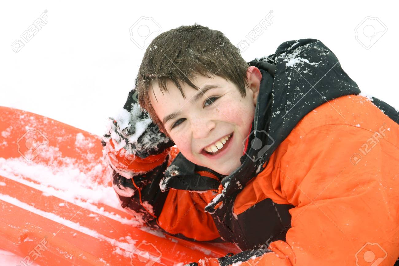 Boy Smiling Laying on his Sled Stock Photo - 778980