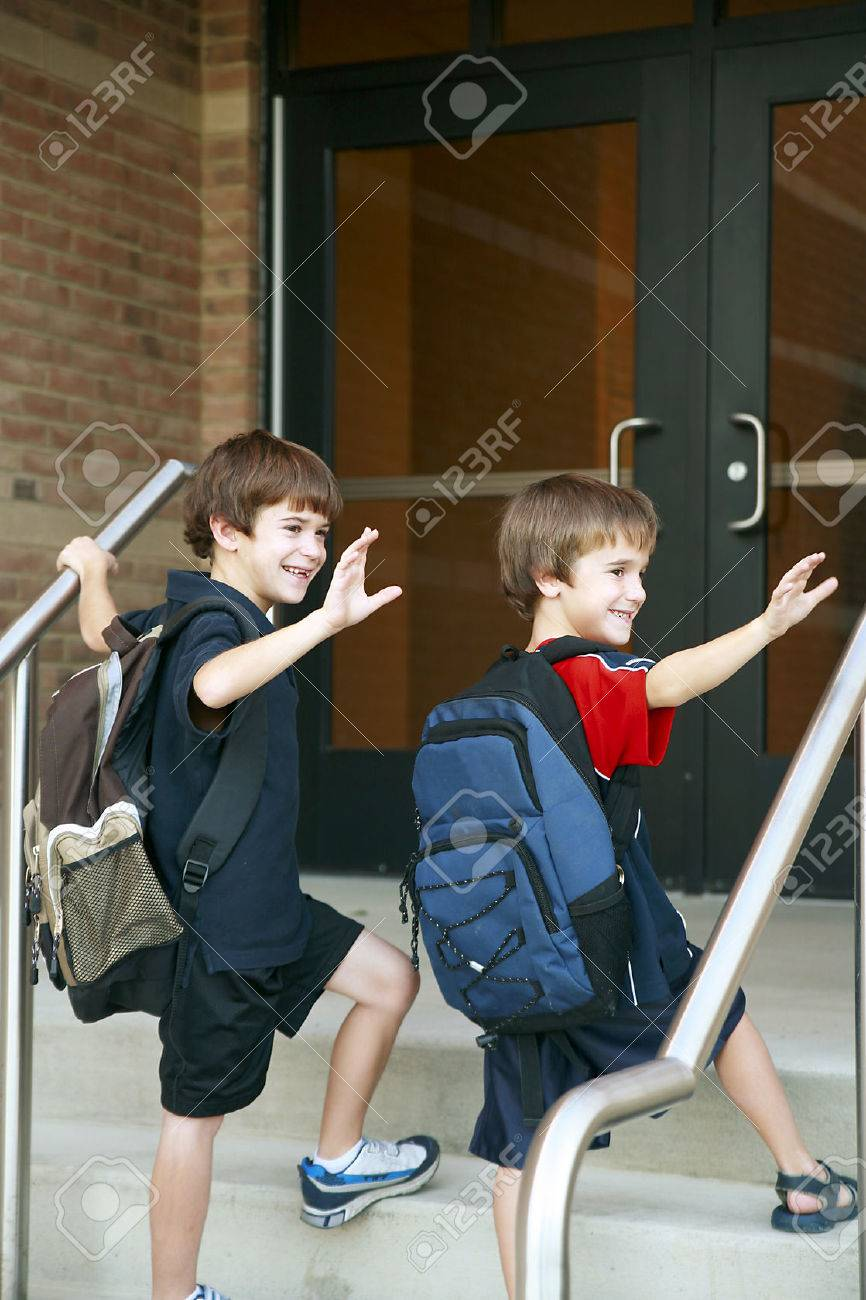 Two Boys Going into School Stock Photo - 1667577