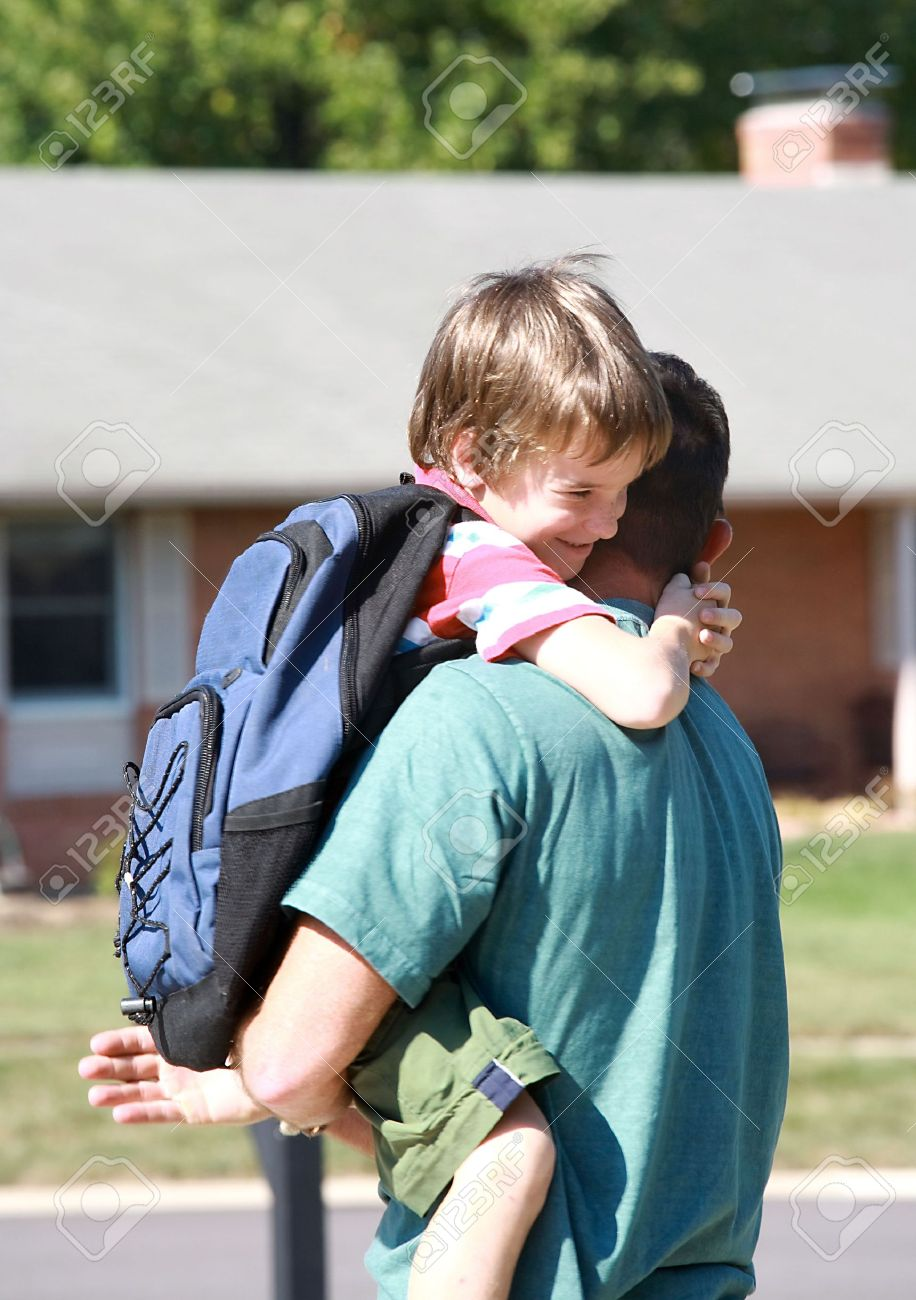 Little Boy Hugging Dad After Long Day at School Stock Photo - 1770539