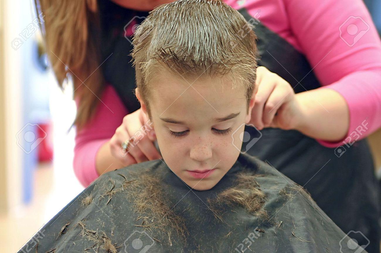 Little Boy Getting A Hair Cut Stock Photo