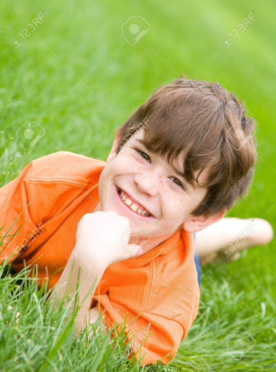 Cute Boy Laying in the Grass Stock Photo - 2949562
