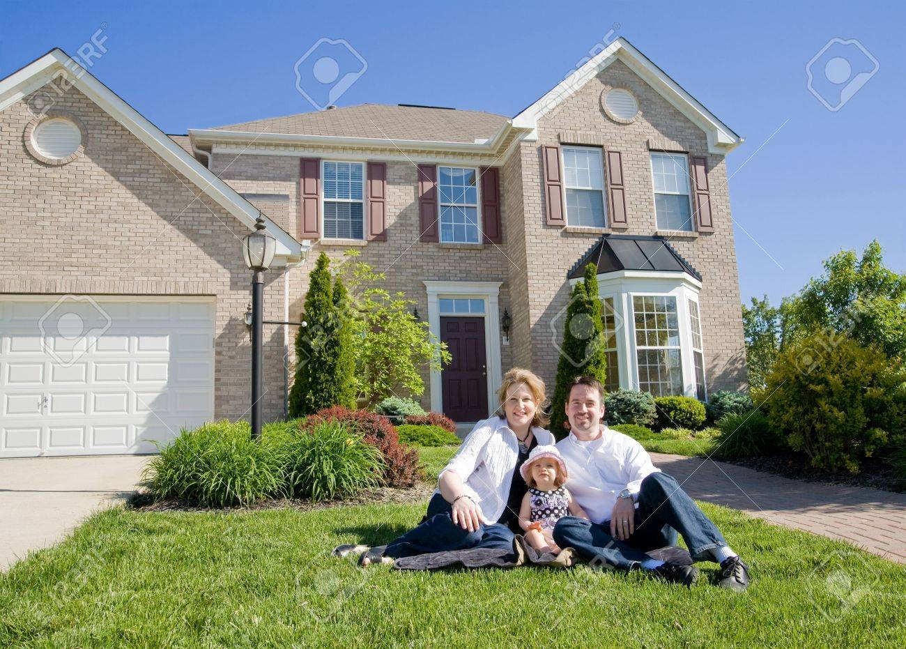 Family in Front of House Stock Photo - 3109371