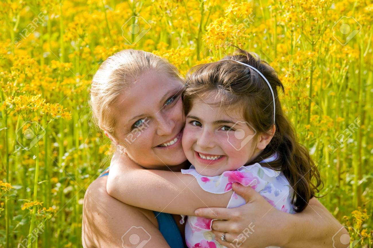 Mother and Daughter in a Flower Field Stock Photo - 3137162