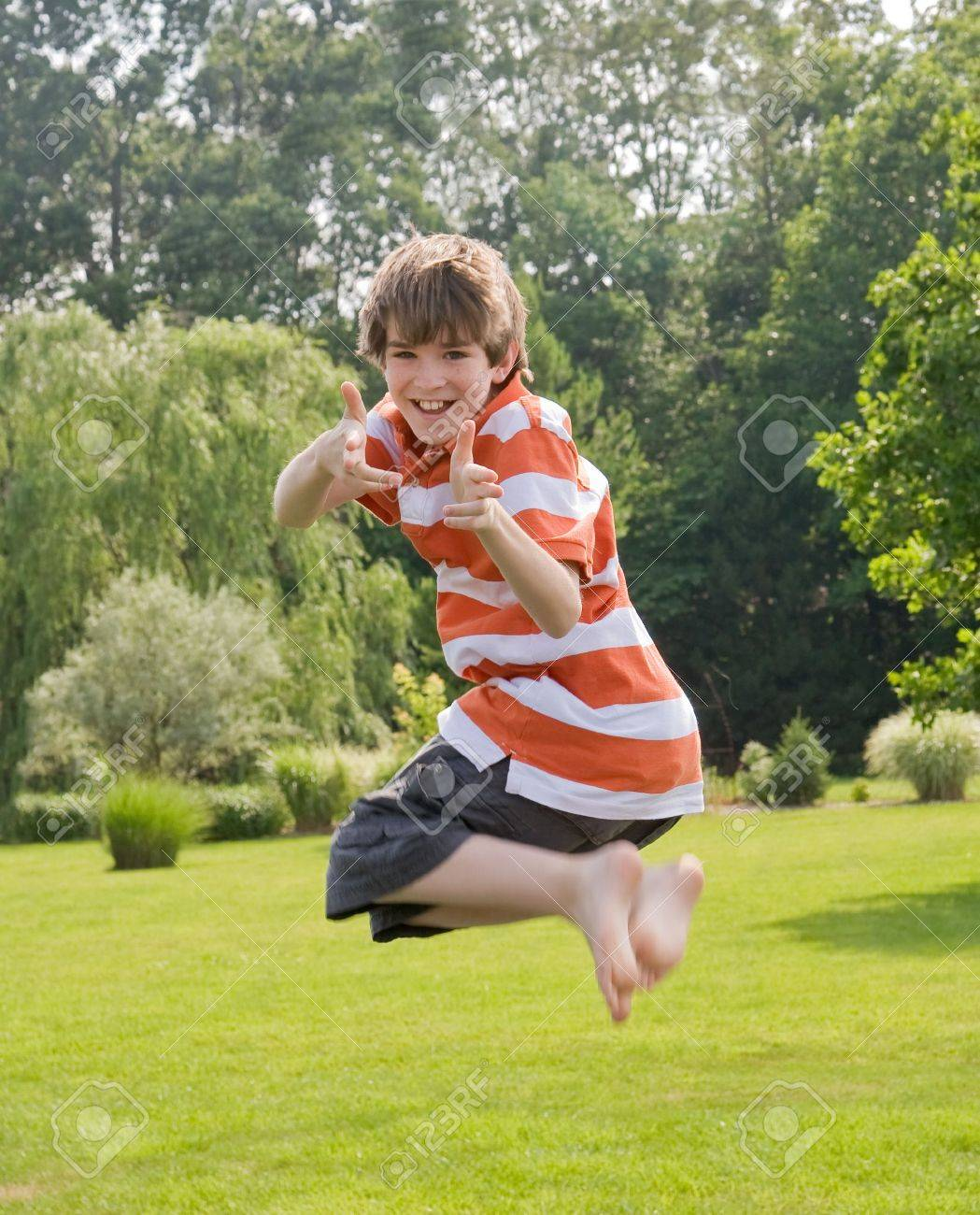 Boy Jumping in the Air - 3239590