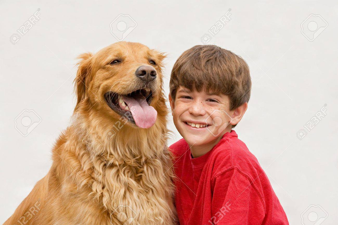 Little Boy with Golden Retriever Stock Photo - 3627778