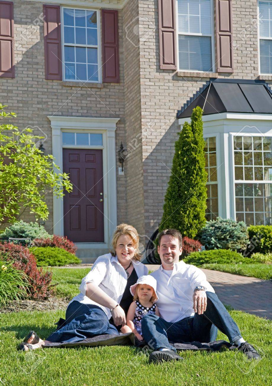 Happy Family in Front of Their Home Stock Photo - 3829677