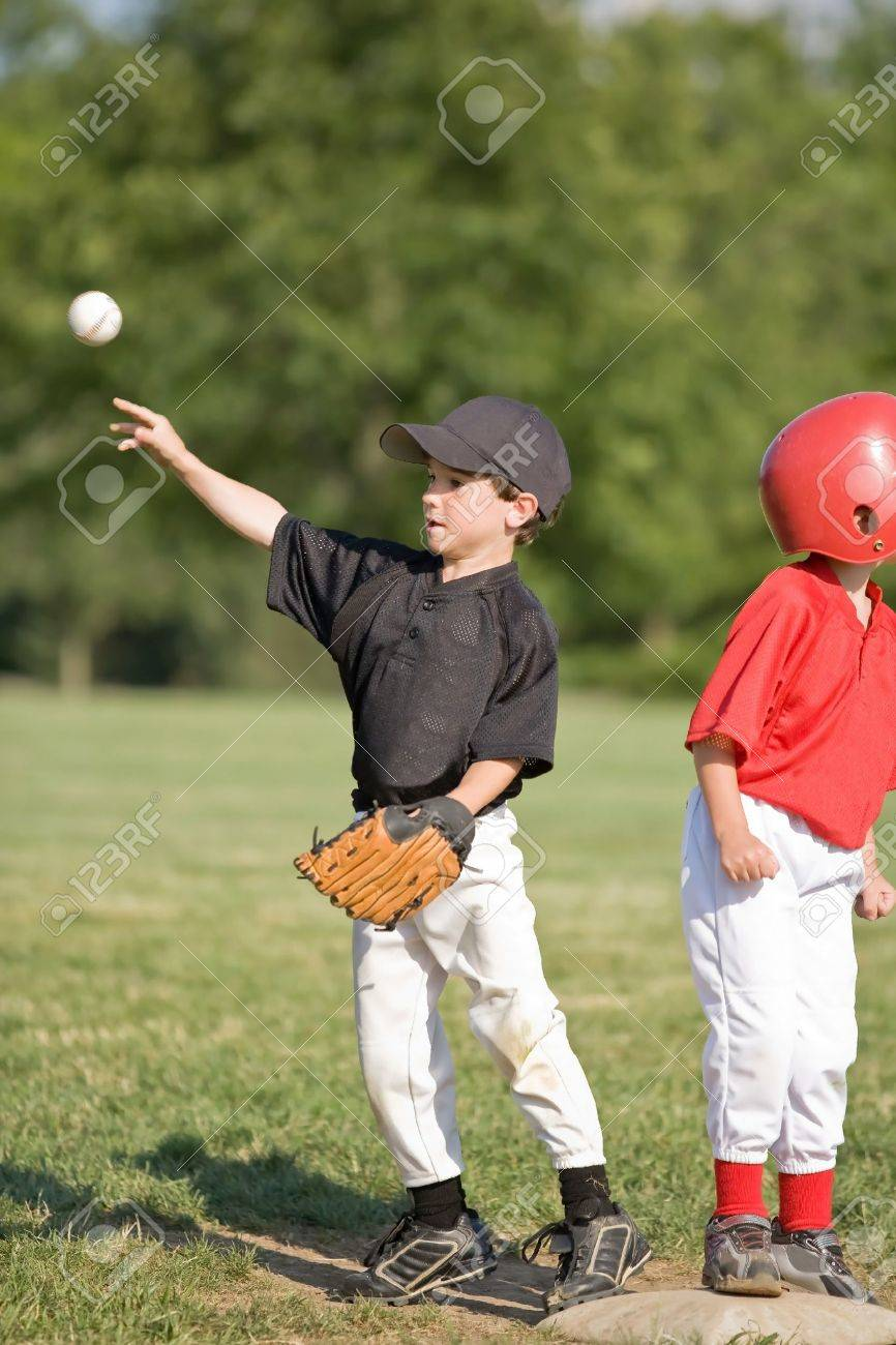 Little Boy Throwing Baseball From First Base Stock Photo - 4143191