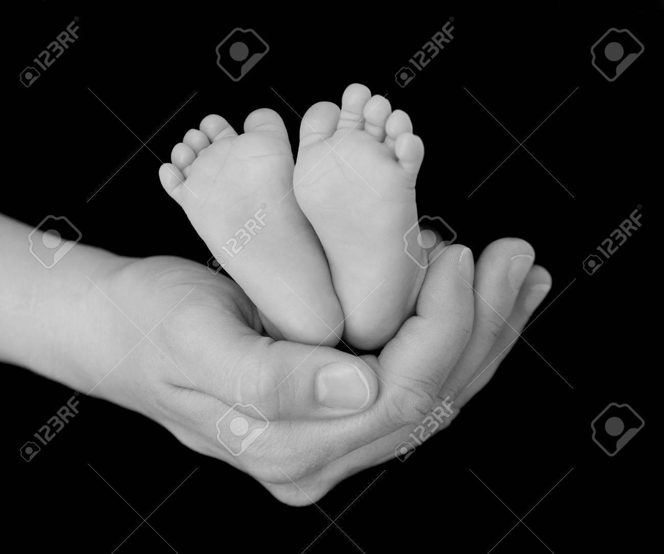 Newborns feet cradled in parents hand stock photo 4554193