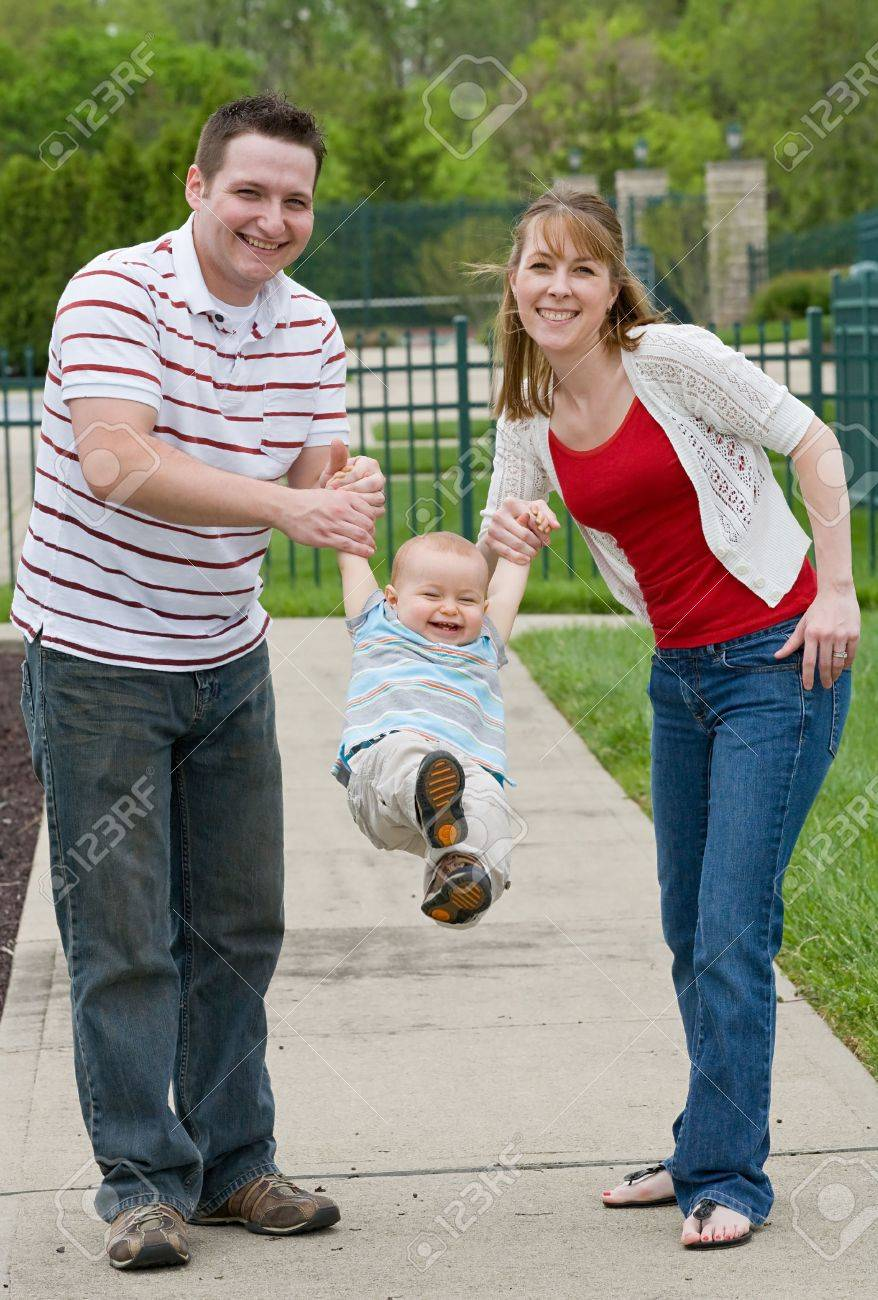 Couple Playing With Their Son - 4942064
