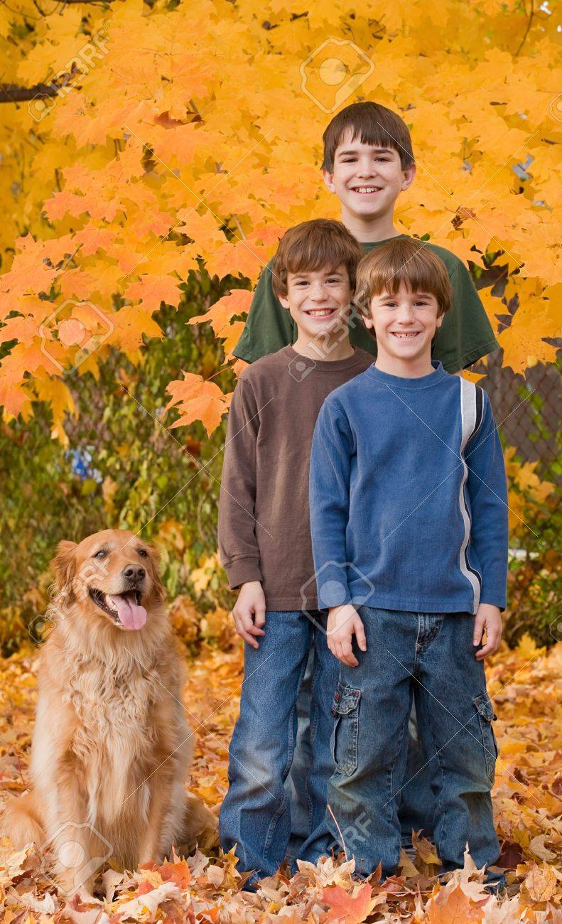 Boys in the Fall Leaves - 5807399