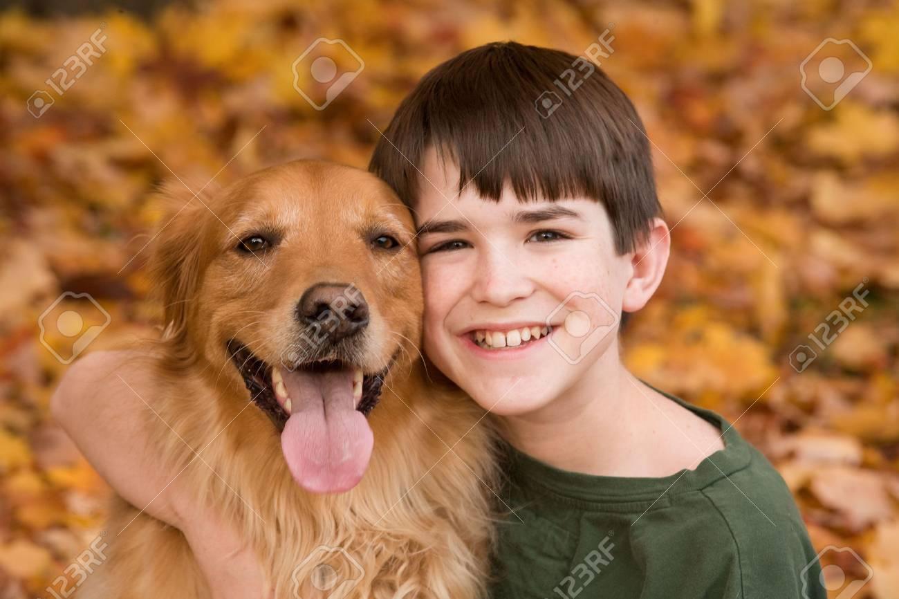 Teenager with Golden Retriever Stock Photo - 5807402