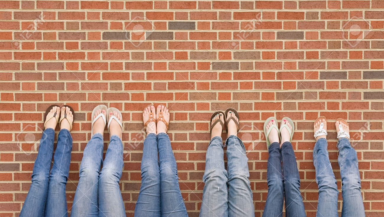 Group of College Girls at School With Legs up on Wall Stock Photo - 5930261