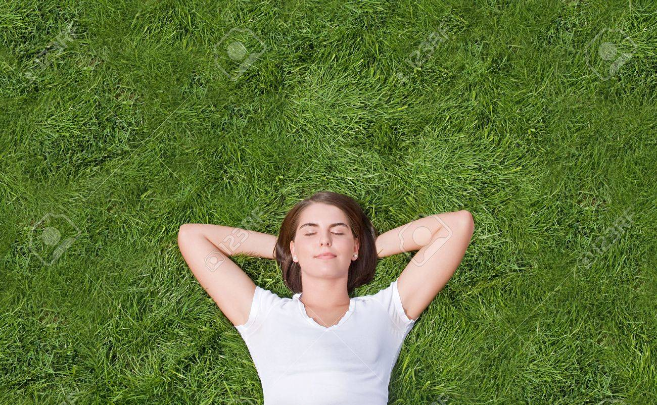 Young Girl Resting in the Grass - 6638837