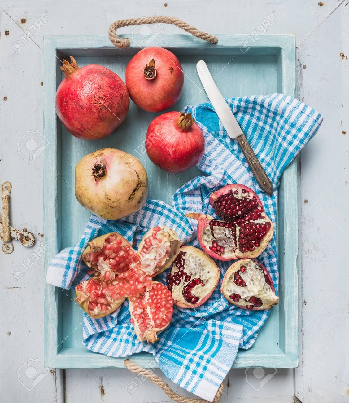 ... Red And Teal Kitchen By Red And White Pomegranates And Knife On Kitchen  Towel In Blue ...