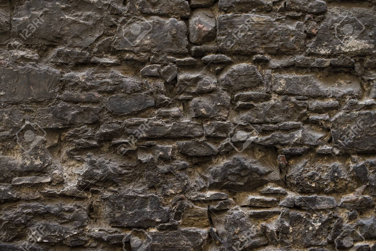 Dark Brown Old Medieval Natural Stone Wall Texture Background Or Wallpaper Stock Photo