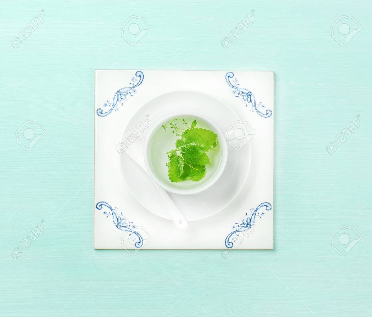 Cup Of Herbal Tea On White Ceramic Tile Board Over Mint Pastel ...
