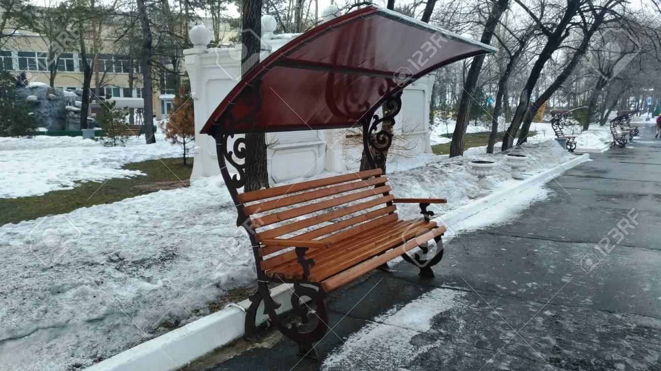 Fabulous Garden Bench With A Metal Peak In The Park On The Path Spring Machost Co Dining Chair Design Ideas Machostcouk