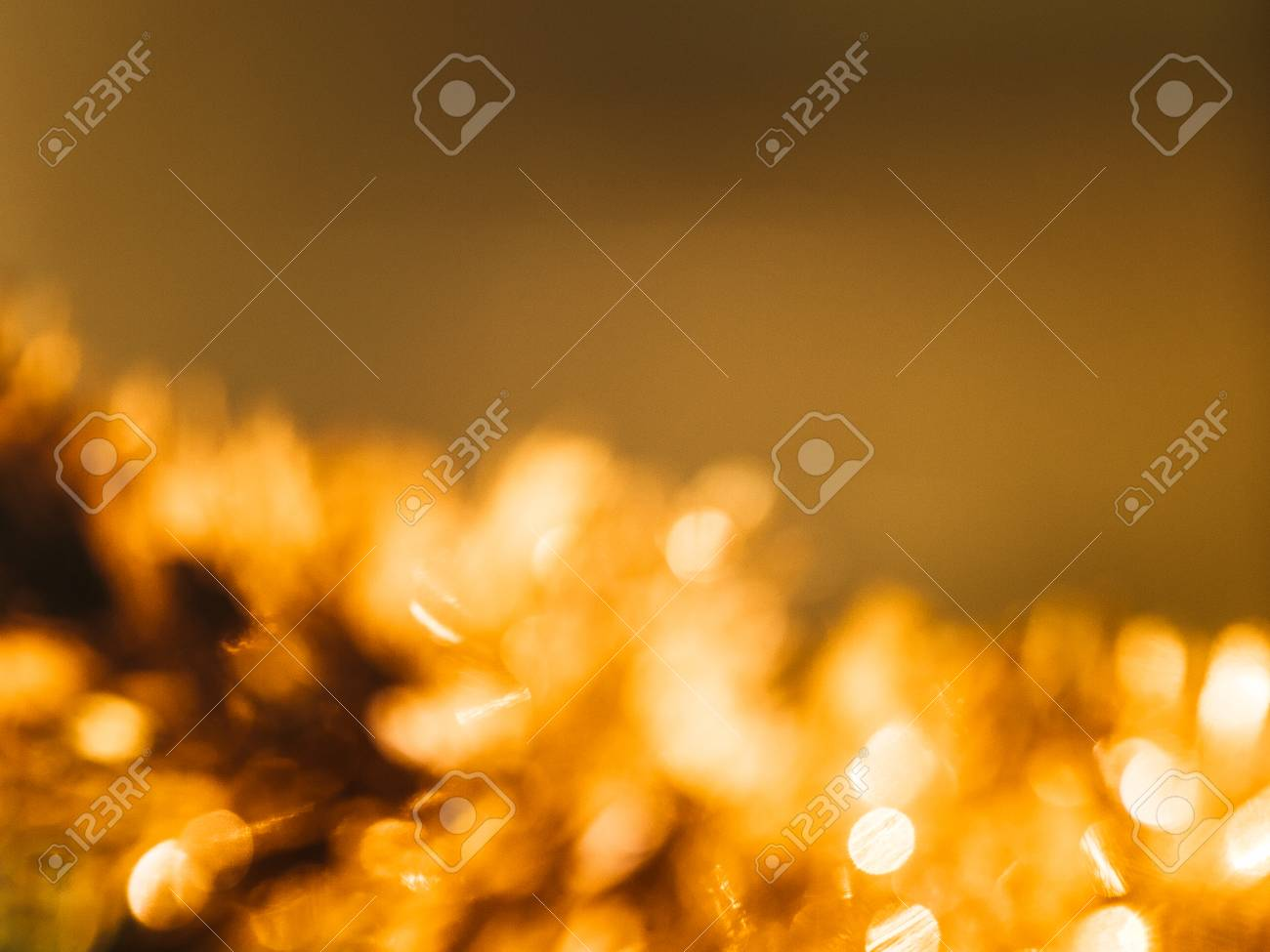 abstract golden new years tinsel on a dark background stock photo 91948539
