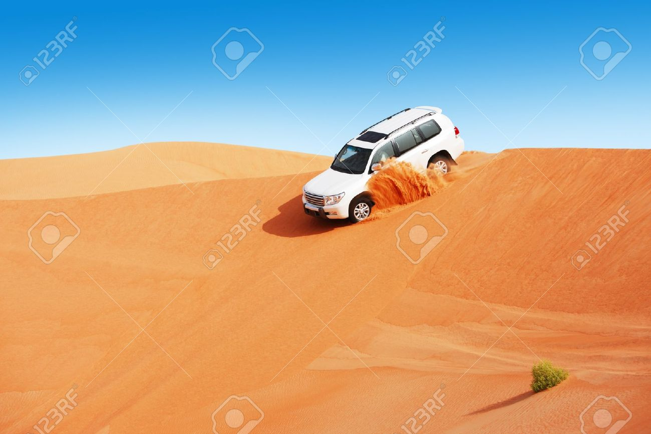 4 by 4 dune bashing is a popular sport of the Arabian desert Stock Photo - 16164172