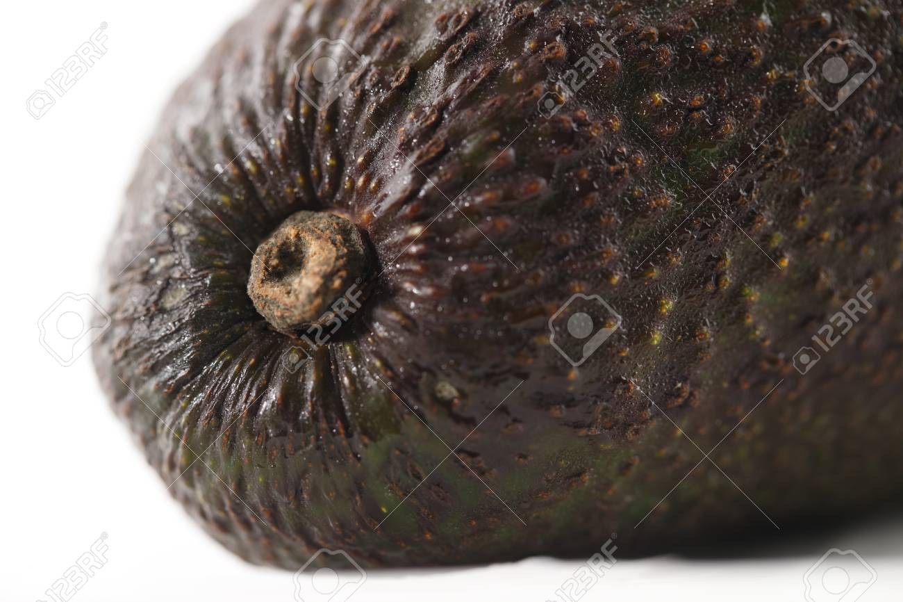 A fresh organic avocado shot in a  creative abstract manner against a white background Stock Photo - 22169878