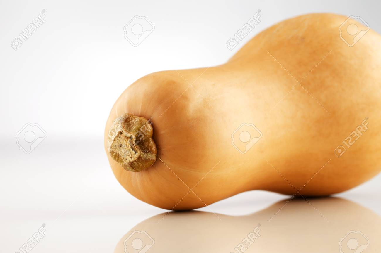A whole organic Australian Squash photographed on a white ceramic surface Stock Photo - 22169823