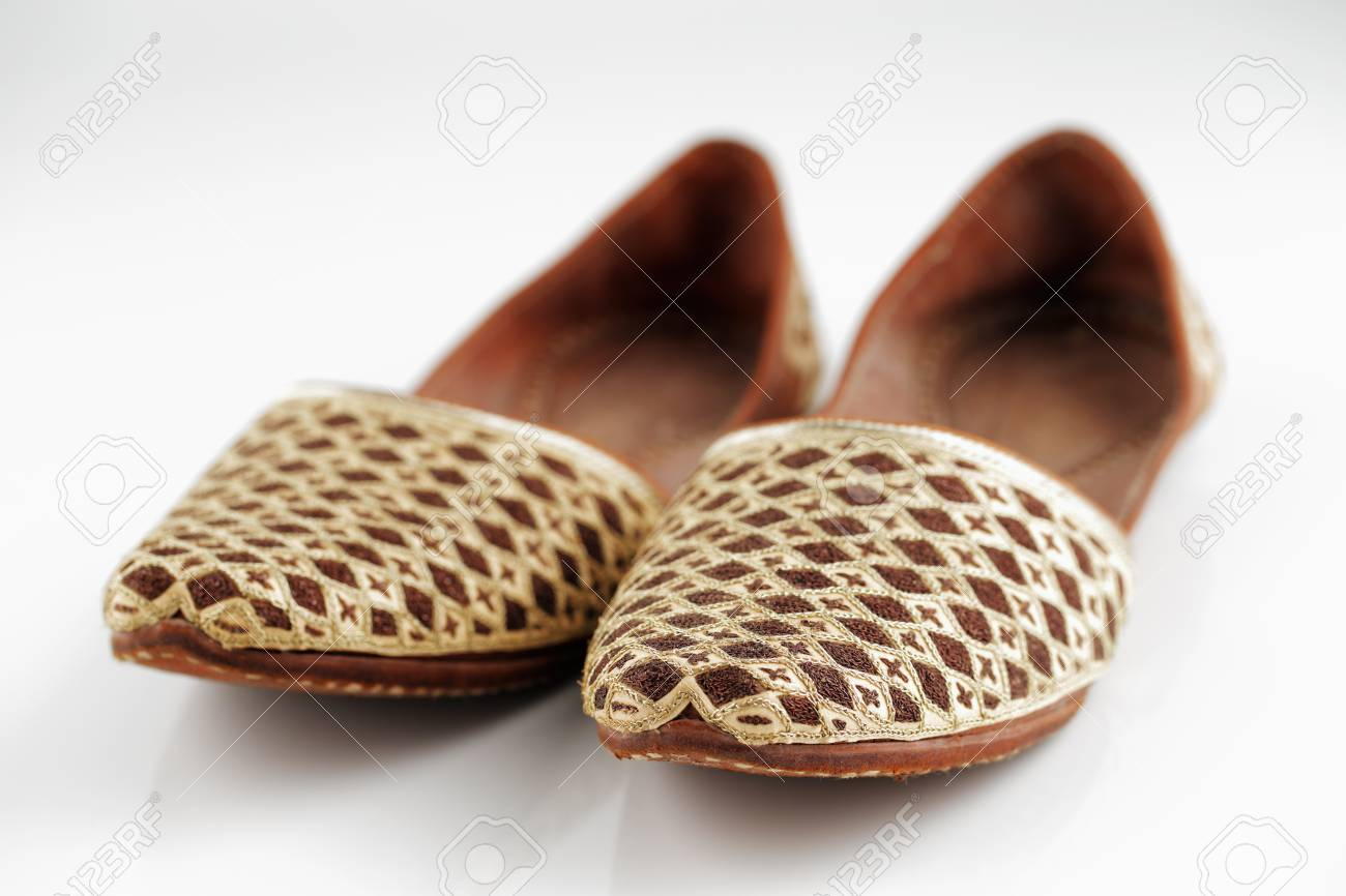 3e7f2b3bdf7 Traditional Arabic slippers shot against a white background Stock Photo -  25971508