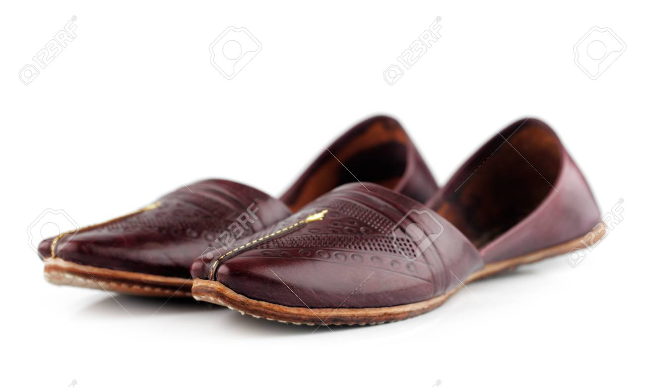a87c5abe8b1 Traditional Arabic slippers shot against a white background Stock Photo -  25971515